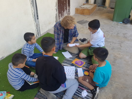 Reading together with teacher Frans