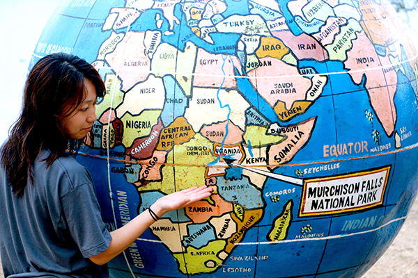 woman pointing at a map of africa