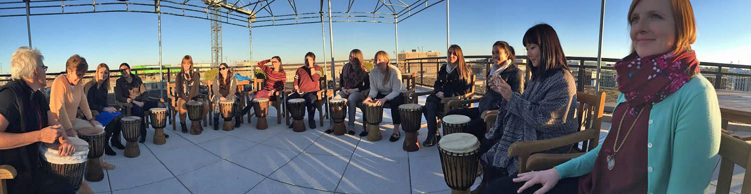 GlobalGiving staff at a drumming circle