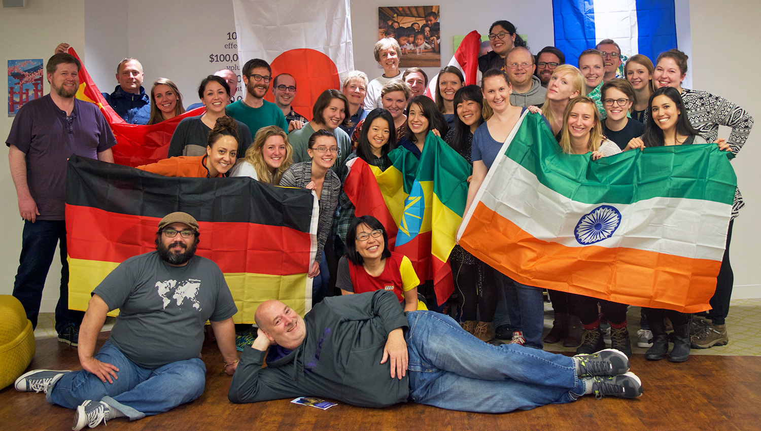 GlobalGiving staff with flags