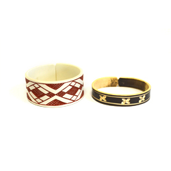 Donation gets you a recycled PVC pipe bracelet made by women of the Namibian Himba tribe!