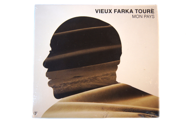 Provide a desk for students in Timbuktu and receive a CD of famous Malian musician Vieux Farka Toure