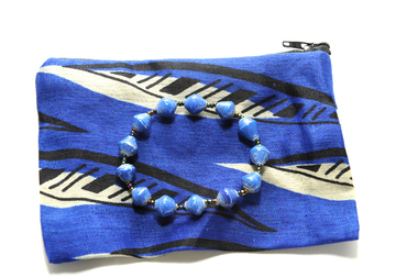 Provide school supplies for a student in Uganda and receive a bracelet and zip pouch