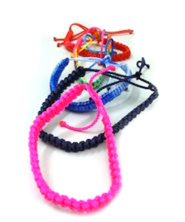 Support school supplies for one girl for one semester and receive a free hand-made bracelet!