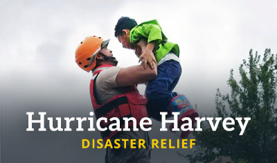 A rescue worker lifts a child. Title reads 'Hurricane Harvey Disaster Relief'
