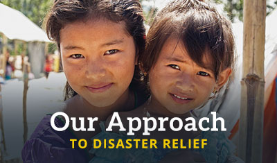 Two young girls smile. Title reads 'Our Approach to Disaster Relief'
