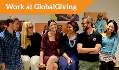 Title reads 'Work at GlobalGiving'. A group of GlobalGiving employees smile
