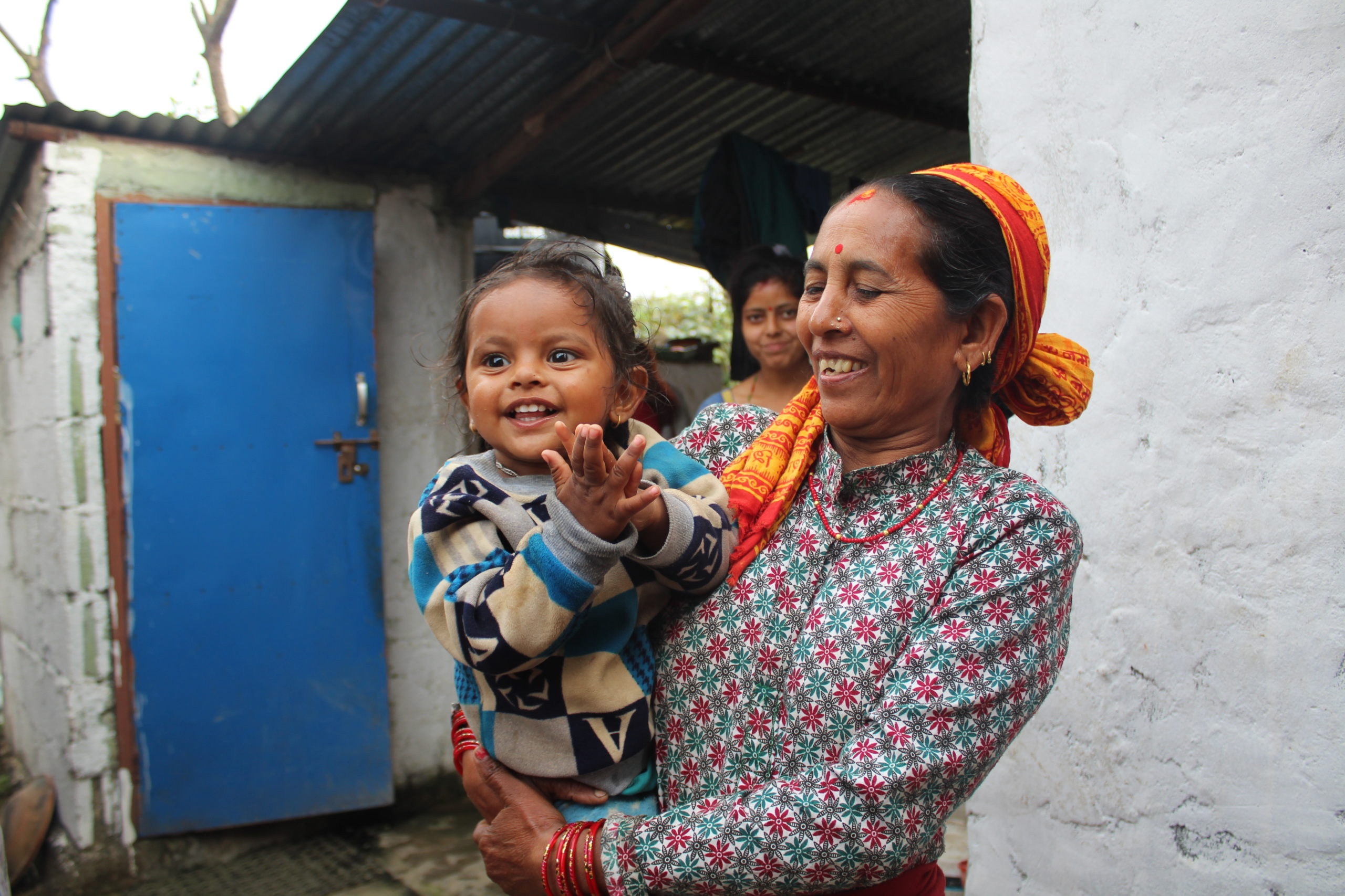 a woman smiling and holding a baby. amazing nonprofit photos