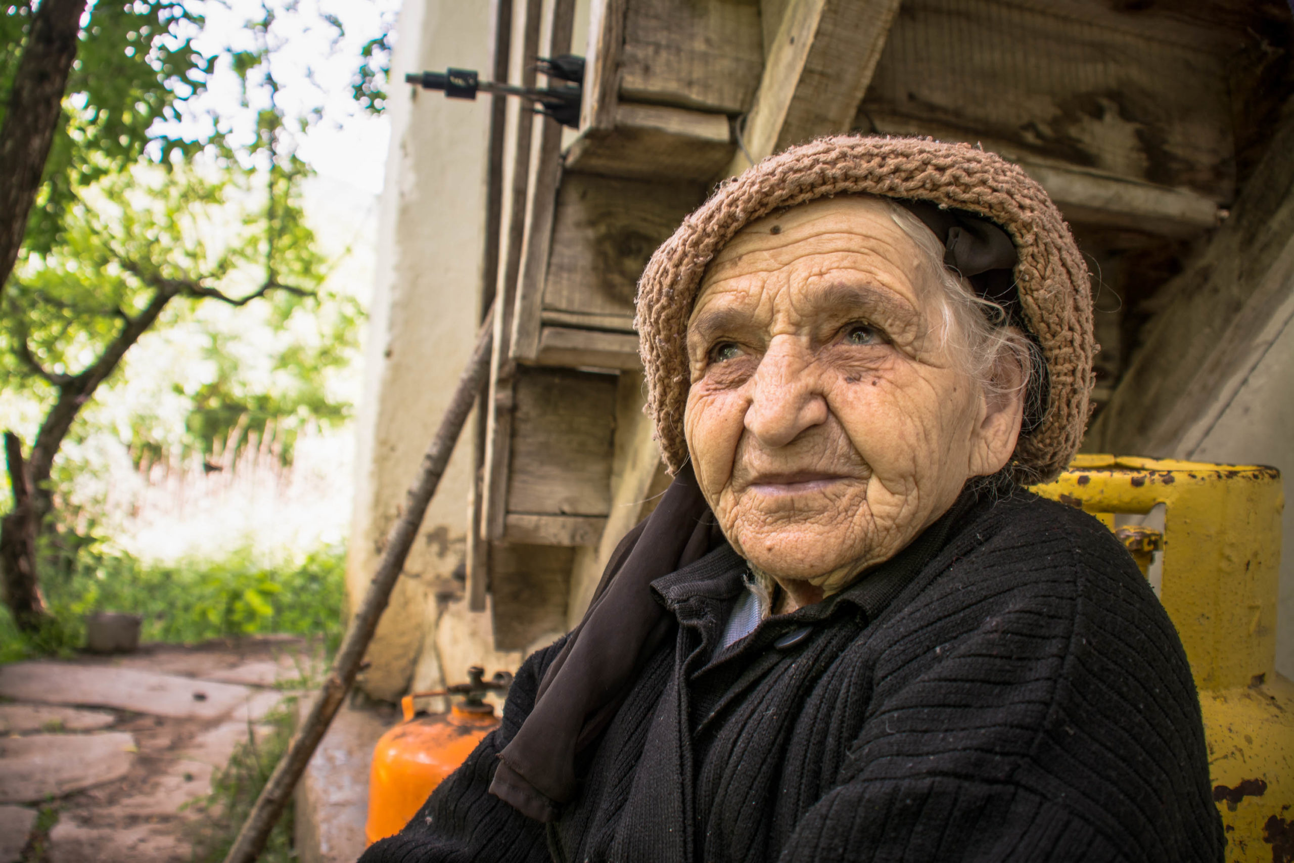 Photo of a smiling woman that is elderly
