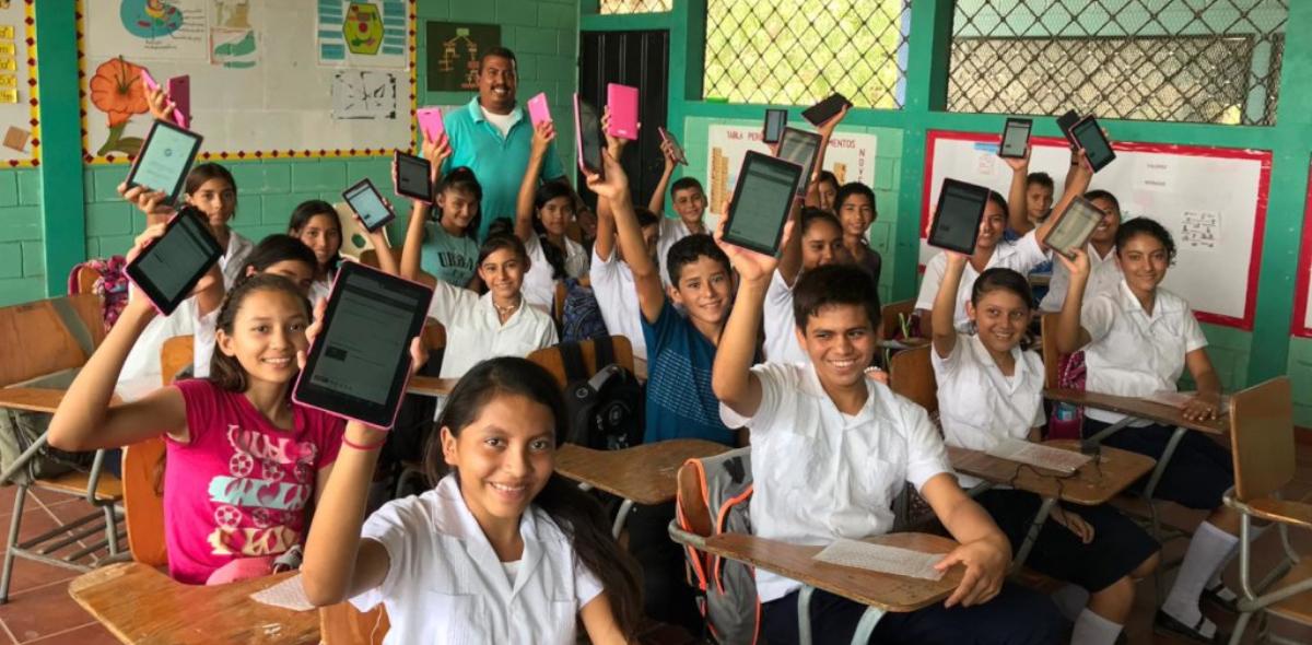 Children holding e-books