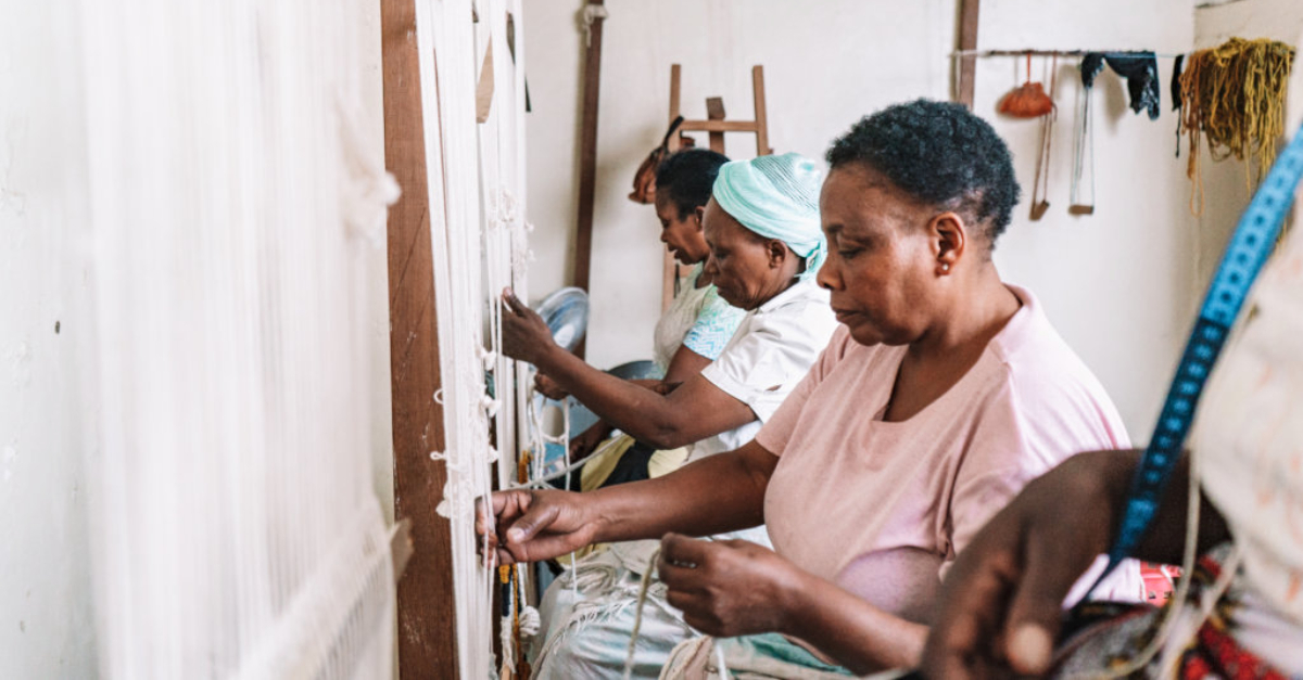 Artisans from Imani Collective working on a project together.