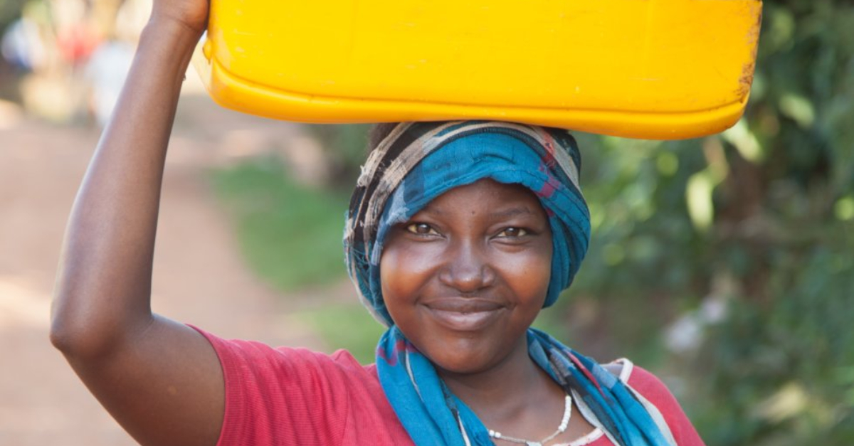 Woman collecting water after a new access point is established