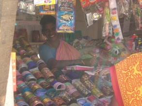 Photo - woman in her shop built with donations through GlobalGiv