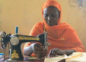 Mairamou, APAD Leader, teaches sewing.