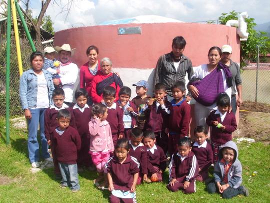 Children proudly display their new school cistern
