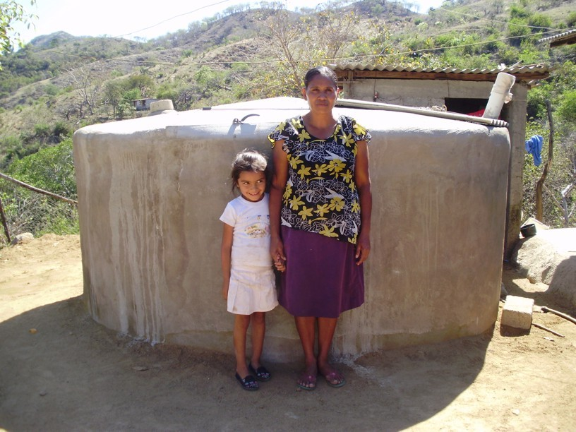 Elicia and daughter with finished cistern