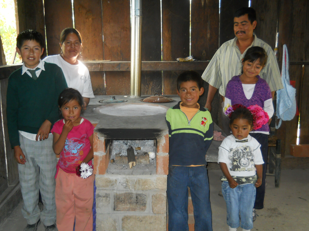 Family with their new fuel-efficient stove