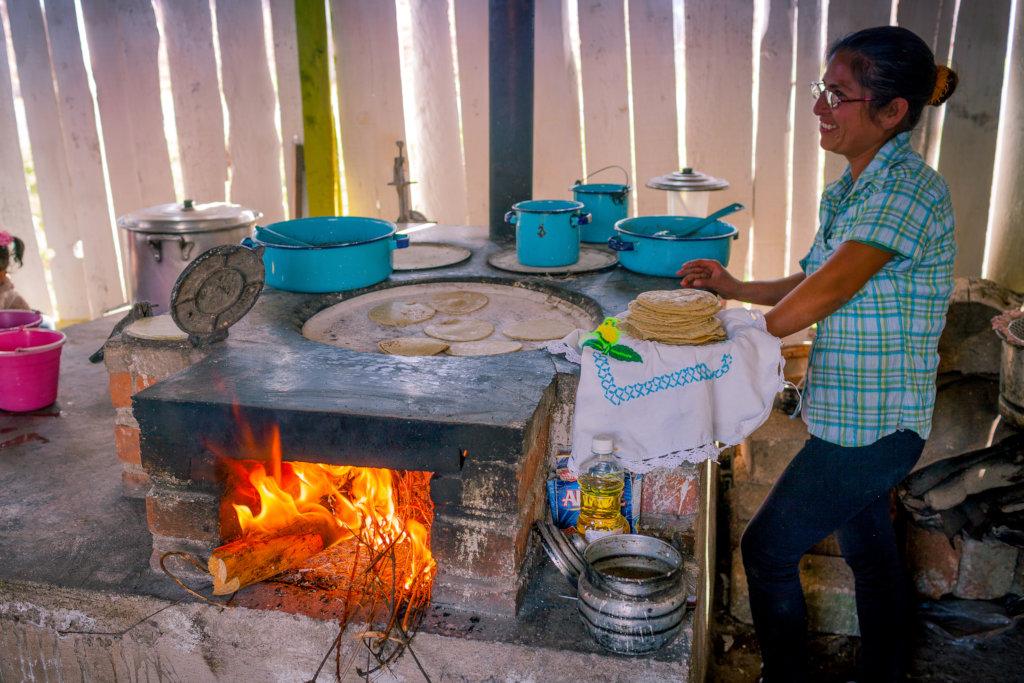 Graciela makes tortillas in fuel-efficient stove
