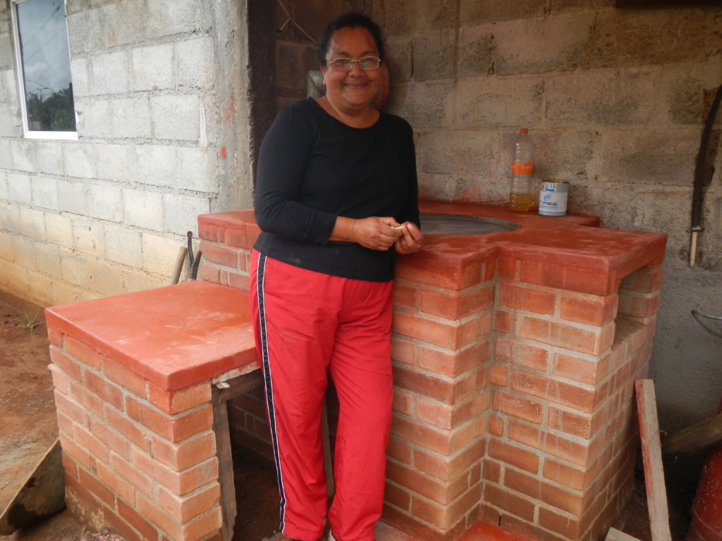 Woman showing of her new fuel-efficient stove