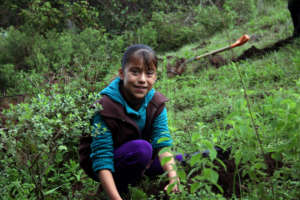 Girl from C.Morales community plants a tree