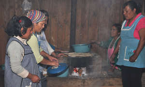Women cooking with fuel-efficient stoves