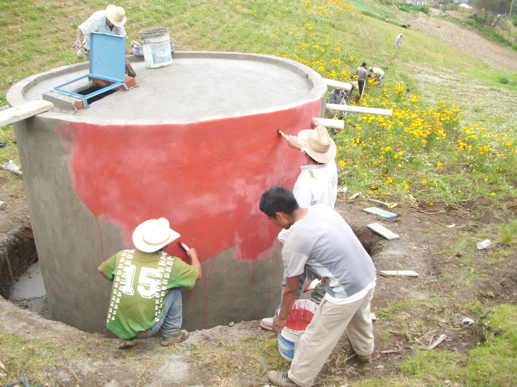 Putting the finishing touches in the cistern