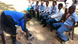 Learning how to make and use a recycled camp stove
