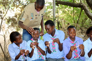 Rovers from 1st Morula Crew helping Scouts learn