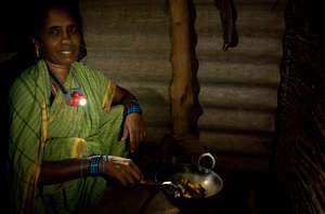 Mother using her NURUlight to cook, Odisha, India