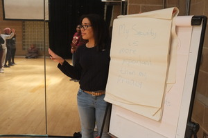 Youth Board member Miriam leads a workshop
