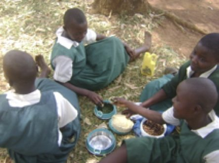 Students at Got Oyenga eating lunch.