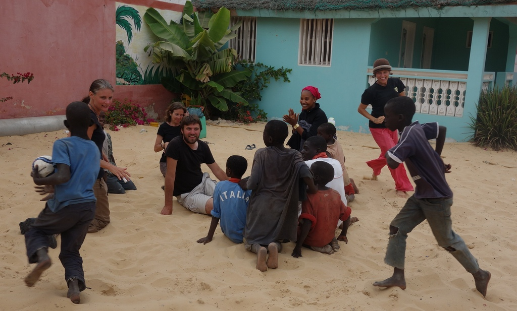 At play in MDG center, with talibes and volunteers