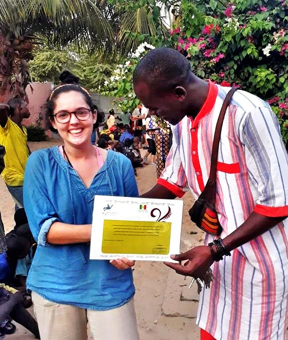 Abdou giving Simone a certificate of appreciation