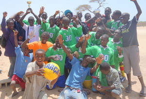 Amadou celebrating with victorious MDG soccer team