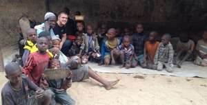 Steven with marabout and children in daara