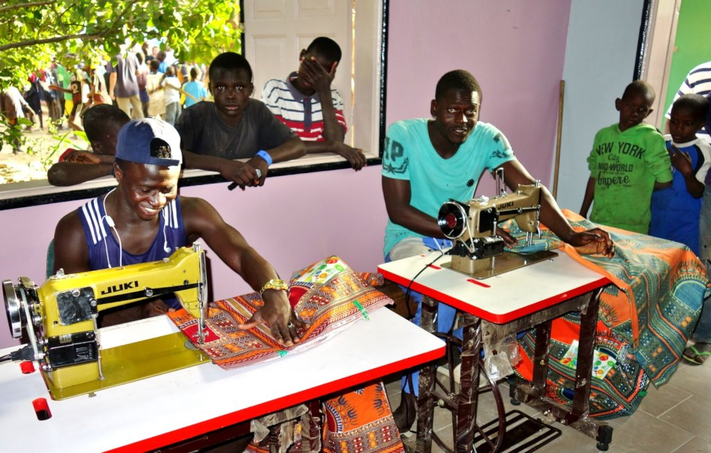 The tailoring center is a magnet for young talibes