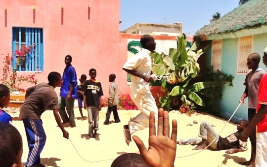 A child at heart - Souleymane skipping
