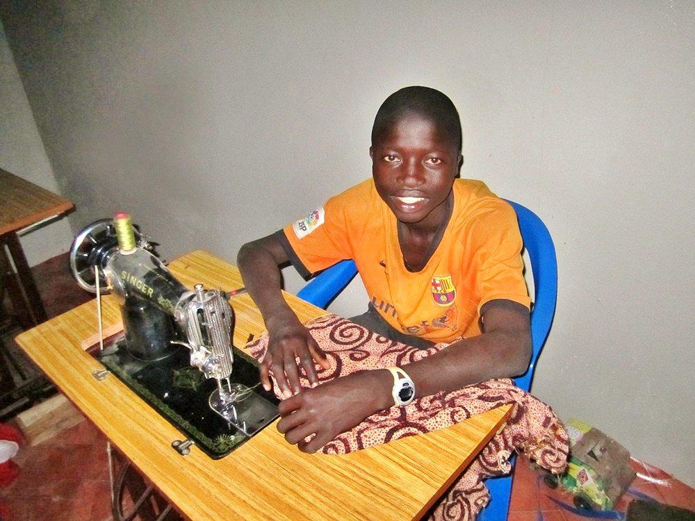 Kalidou learning to sew at Maison de la Gare