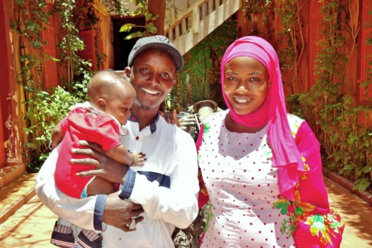 Cheikh and his Ndeye with their son Amadou in 2018