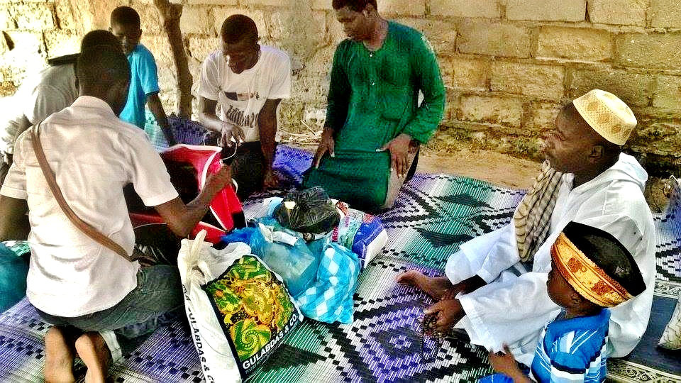 Volunteers distribute clothes and gifts in a daara