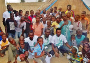 With children after installing mats, mosquito nets