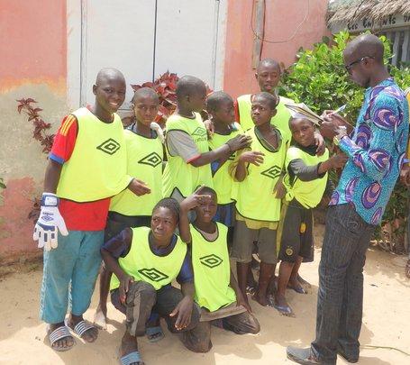 Noel registering children of one of the teams