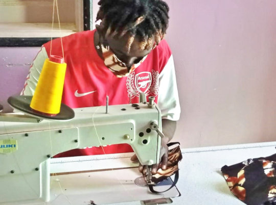 Tailoring apprentice fabricating a mask
