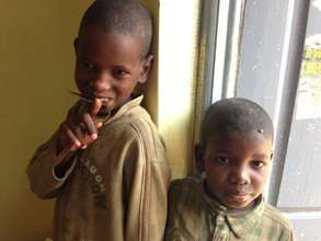 Young talibe children waiting for their gi