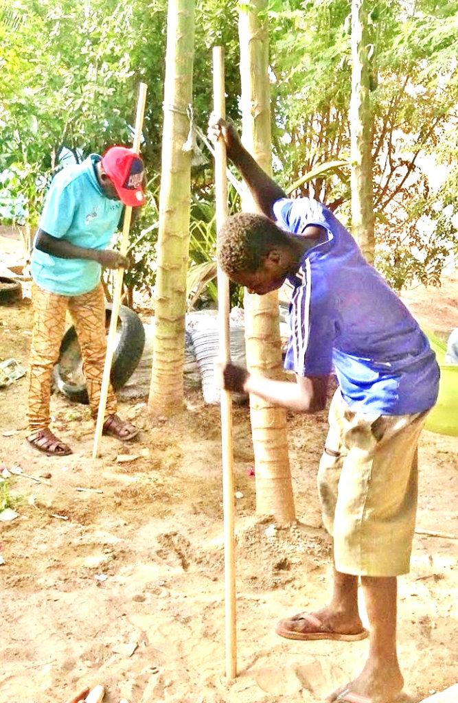 Mamadou and Samba sanding their new Bo staves