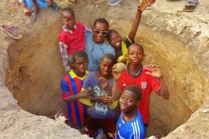 With other talibes in Bango water well