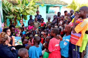 Reading to children amassed in the courtyard