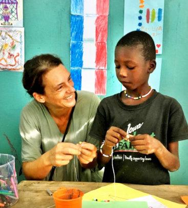 Katia helps a talibe student