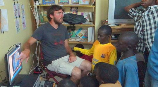 Volunteer Michael teaching with Google Earth