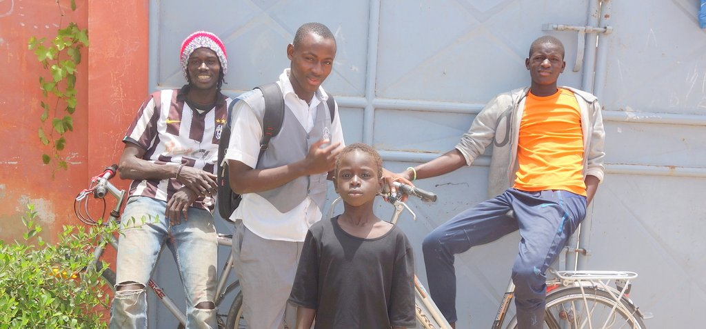 Arouna arrives home from school, to his MDG family